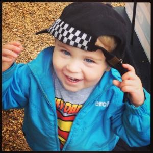 toddler in police hat dressing up