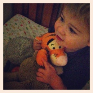 toddler with tigger and ewan the sheep