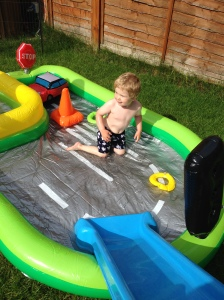 toddler sliding into pool